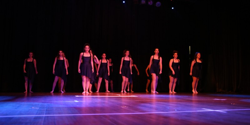 Teenage dance students performing in concert