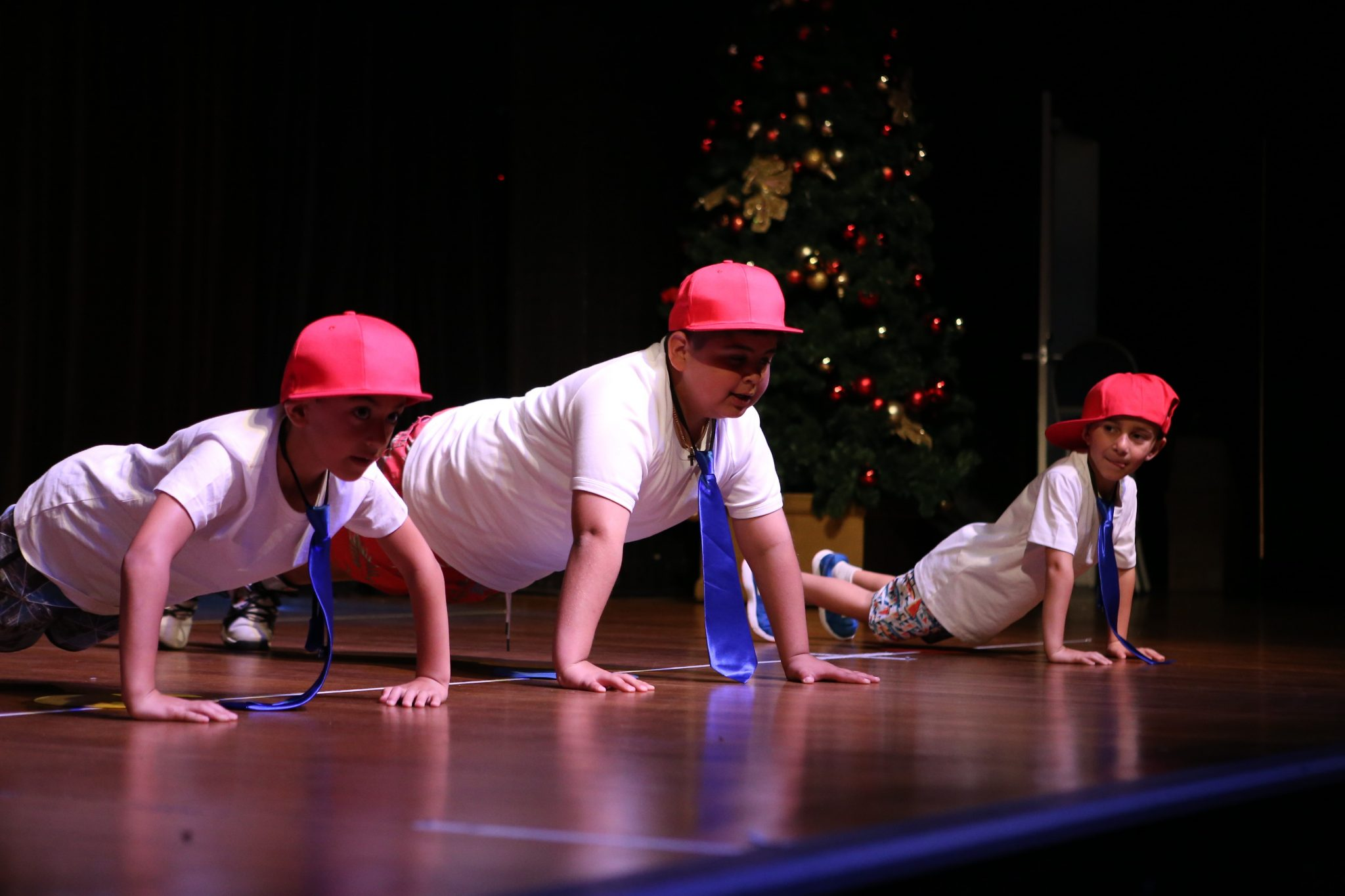 Pre-teen boys performing Hip Hop at dance concert