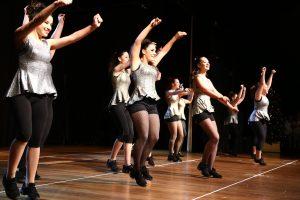 Teenage girls in grey dancing