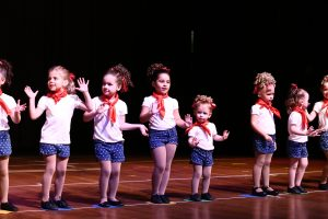 Young pre-school aged girls dressed as sailors dance